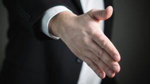 Change Your Past Corporate donation handshake